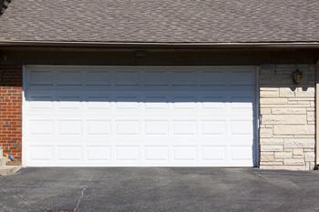 Garage door repair brentwood ny 631 478 6822 broken for Surprise garage door repair